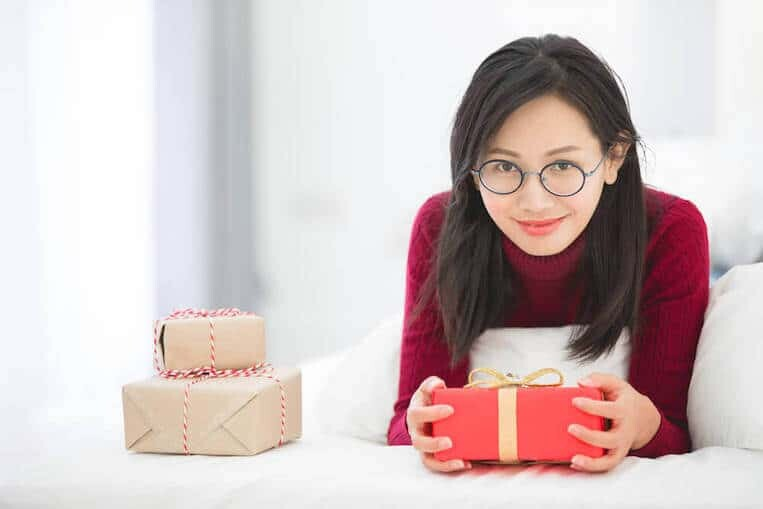 Cute South Korean girl with gift box